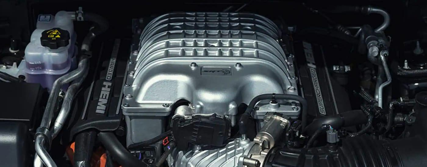 A close up is shown of the supercharged Hemi engine in a 2021 Dodge Durango.