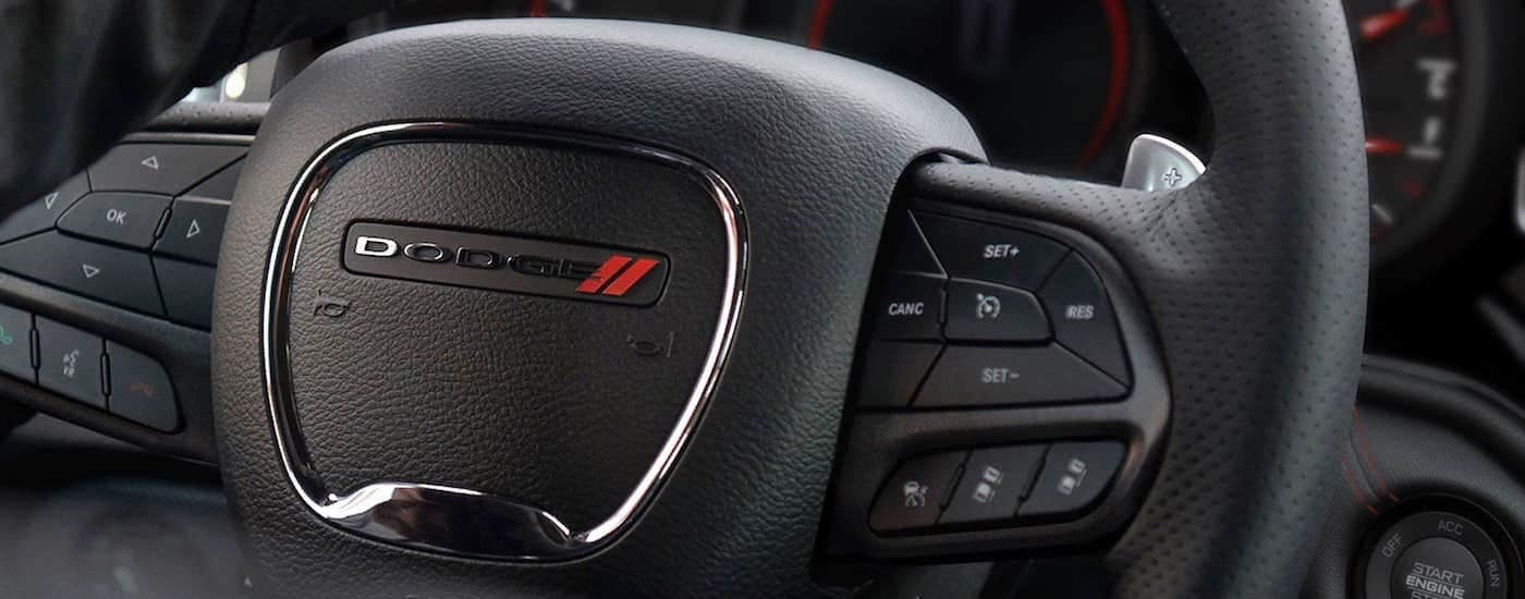 A close up is shown of the steering wheel and gauge cluster in a 2021 Dodge Durango.