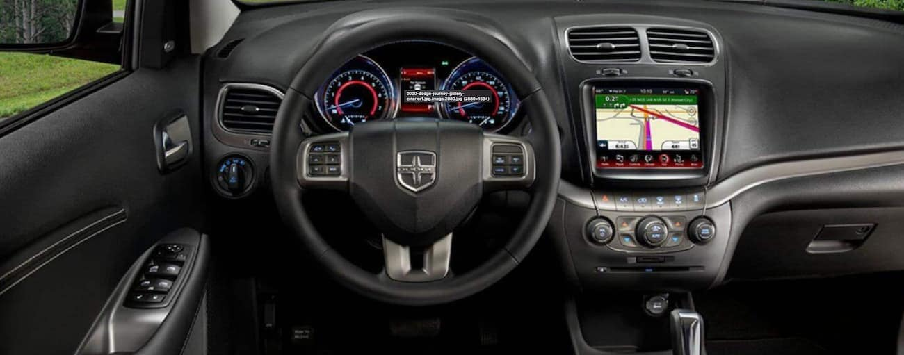 The black interior of a 2020 Dodge Journey is shown.