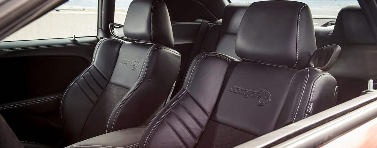 The black interior of a 2021 Dodge Challenger is shown.