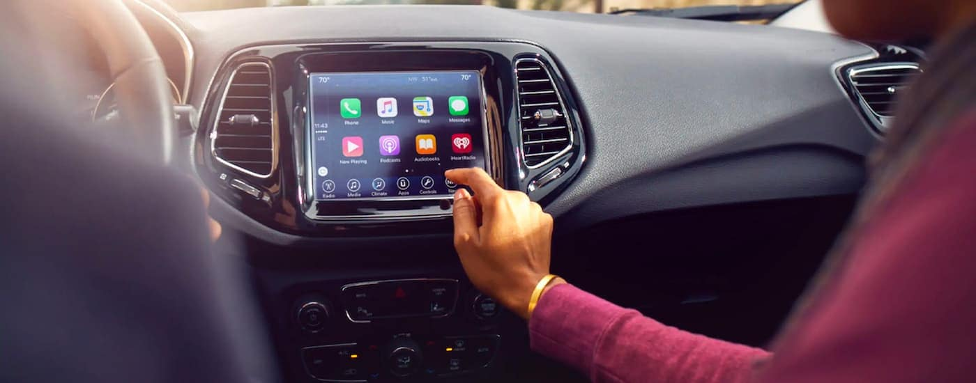 A close up shows the infotainment screen and applications in a 2021 Jeep Compass.