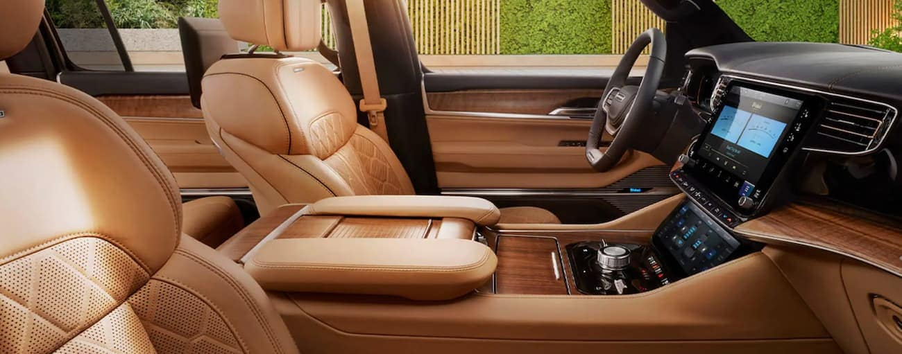 The tan and wood interior is shown in a 2022 Grand Wagoneer.