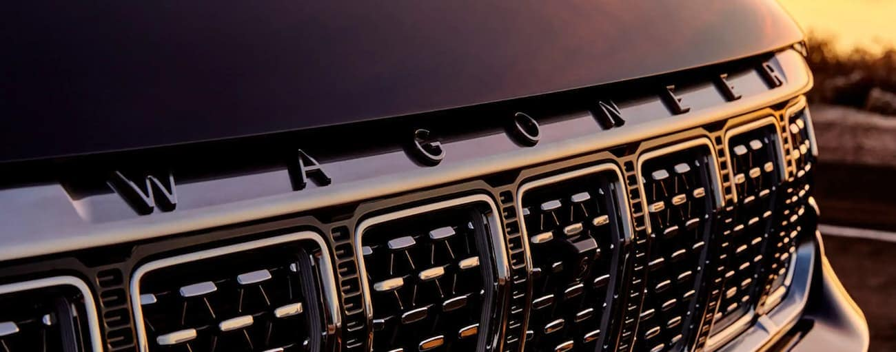 The grille of a black 2022 Wagoneer is shown in closeup.