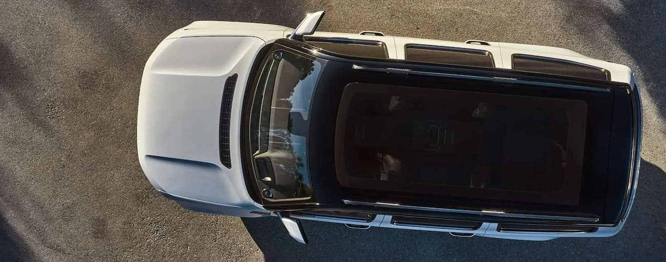 A white 2022 Wagoneer is shown from above on pavement.
