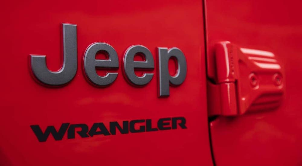 A closeup shows the side Jeep Wrangler badging on a red 2020 used Jeep Wrangler Rubicon.