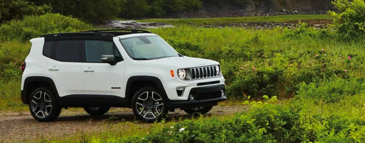A white 2021 Jeep Renegade is shown parked in an empty field.