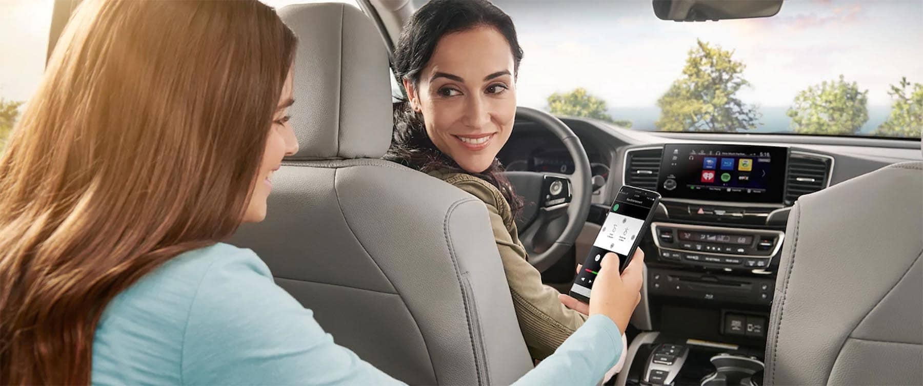 Mom and Daughter using phone app for Honda Pilot Technology