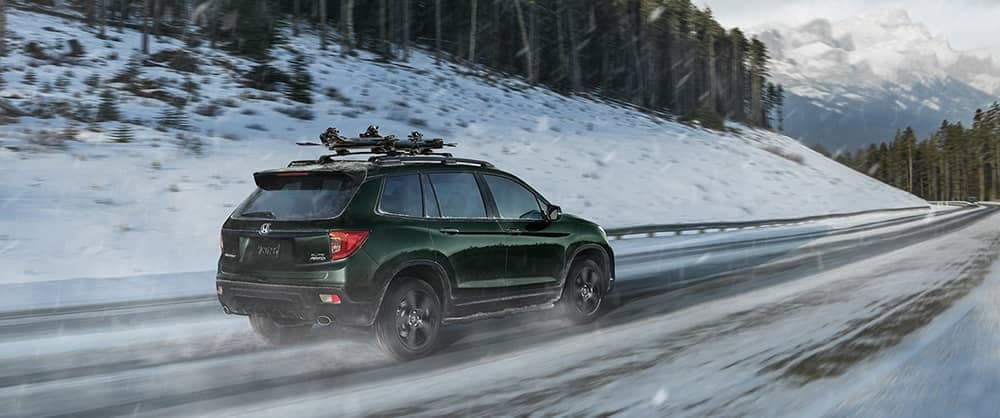 2019 Honda Passport driving through snow