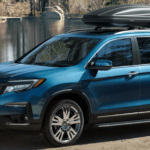 2019 Honda Pilot near lake with 27 mpg