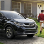 2019 Honda CR-V LX with family and house