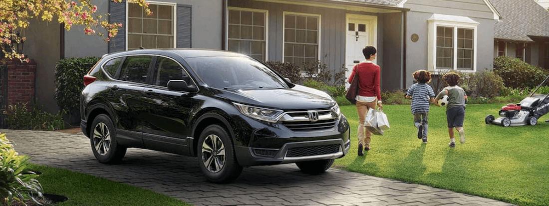2019 Honda CR-V LX with family and house