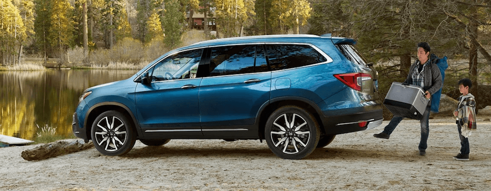 2020 Honda Pilot Elite trim with family near lake
