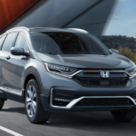 2020 Honda CR-V Hybrid version driving on highway bridge
