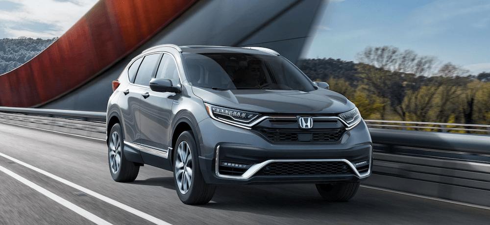 2020 Honda CR-V Hybrid version driving on highway bridge