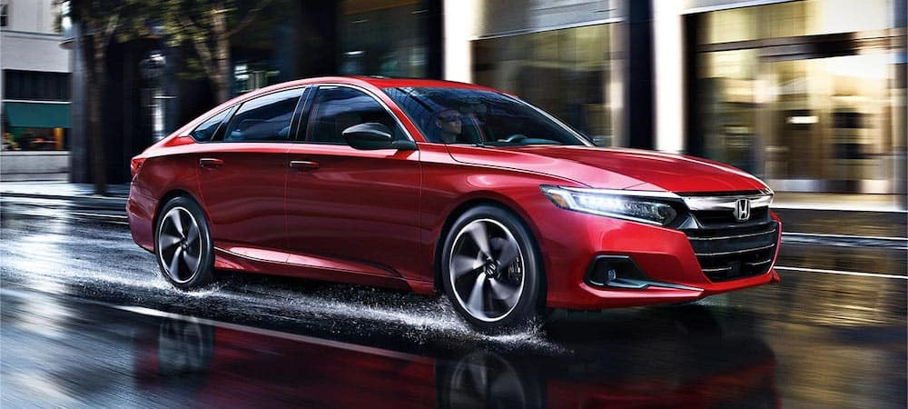 2021 honda accord red exterior driving down slick road