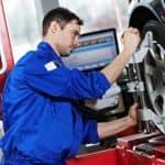 mechanic aligning tires