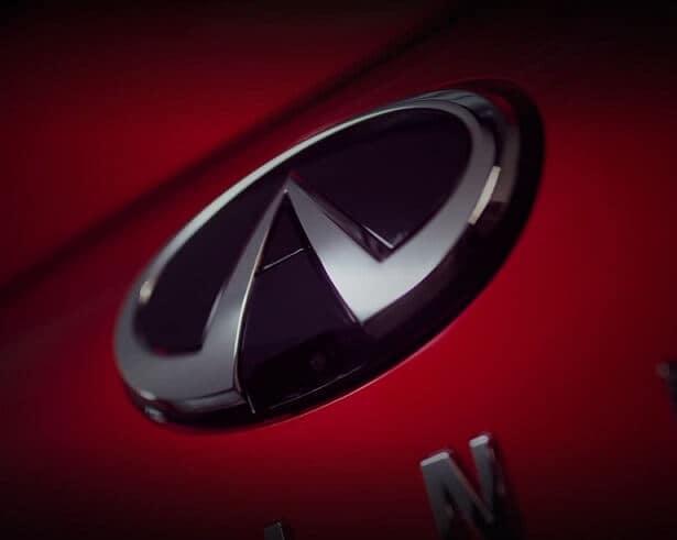 INFINITI Logo Close Up on Red Car