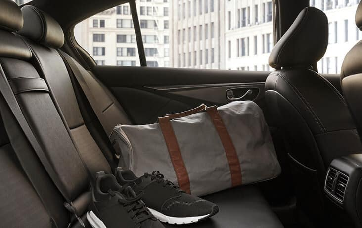 A gym bag in the back of a 2020 INFINITI Q50