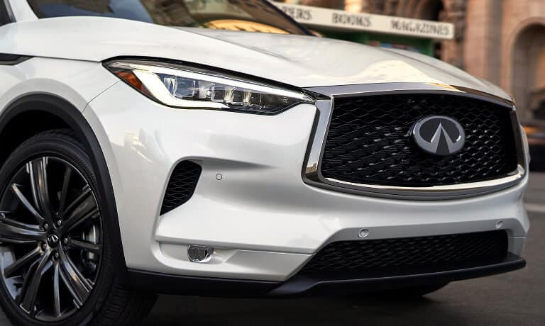 The front grille of a white 2020 INFINITI QX50