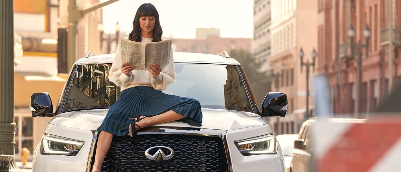 A woman sitting on the 2020 INFINITI QX80