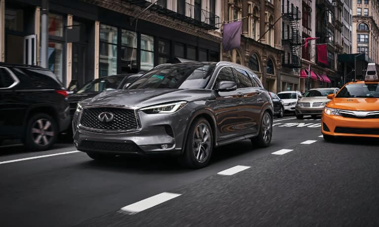 2021 INFINITI QX50 driving in city block
