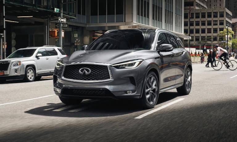 2021 INFINITI QX50 exterior driving down city street