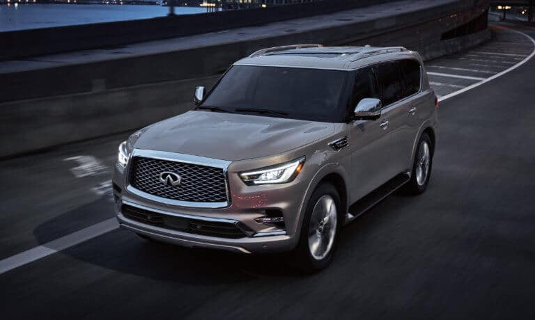 2021 INFINITI QX80 driving on a street