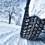 Car tires on snowy road
