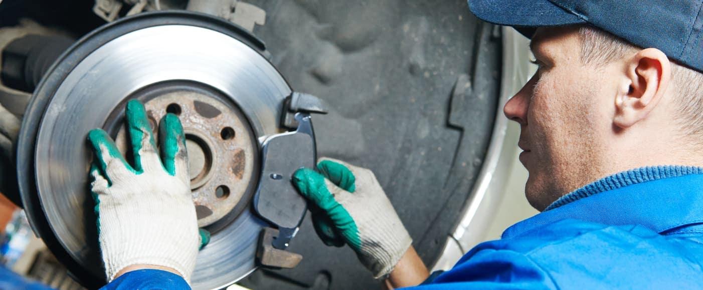 Technician Repairing Brakes
