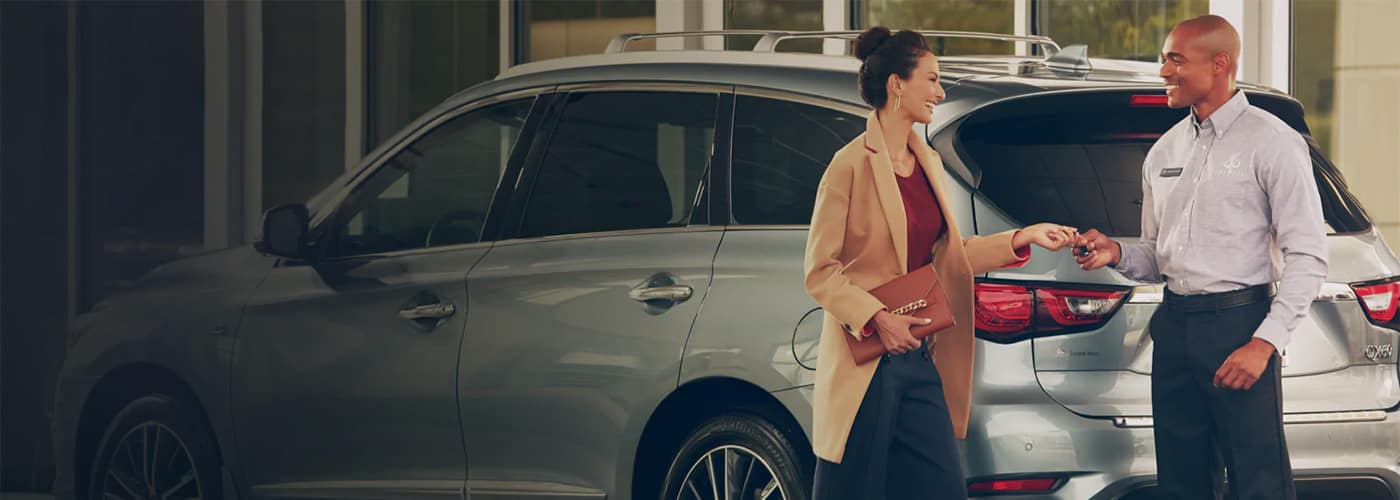 Woman checking into INFINITI Service Department