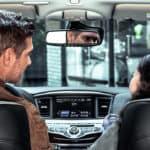 Couple driving INFINITI QX60
