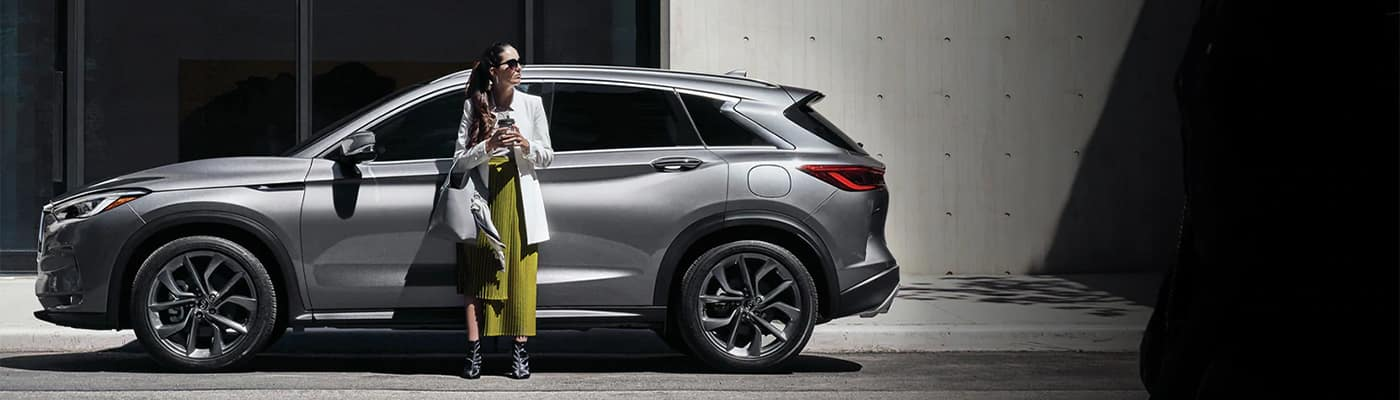 INFINITI SUV with lady leaning