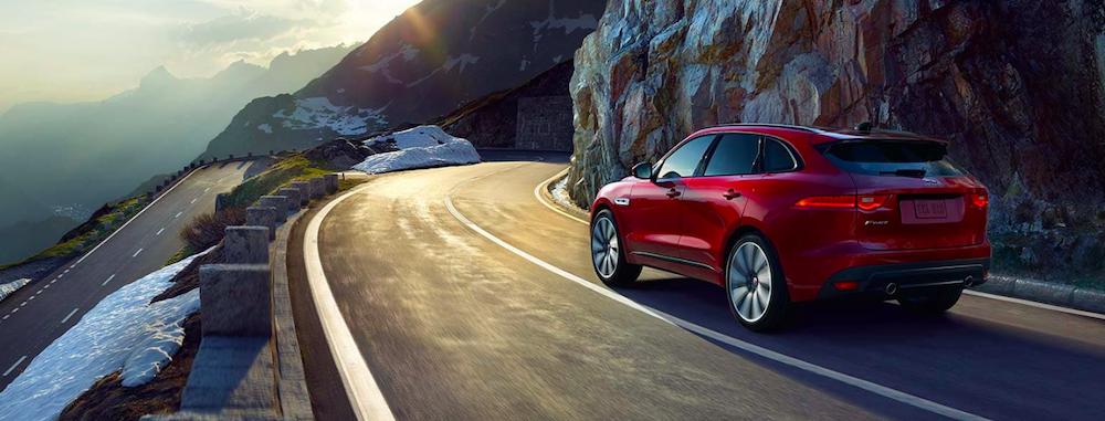 2019 jaguar f-pace red driving