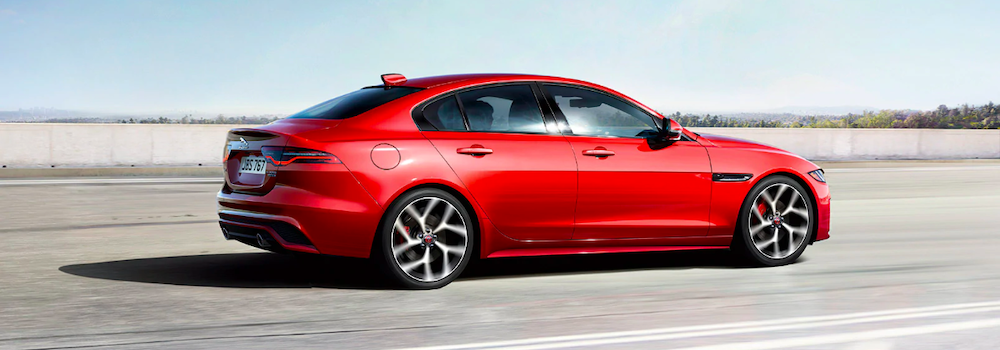 2020 jaguar xe red exterior driving on road