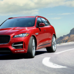 red Jaguar F-PACE on the road