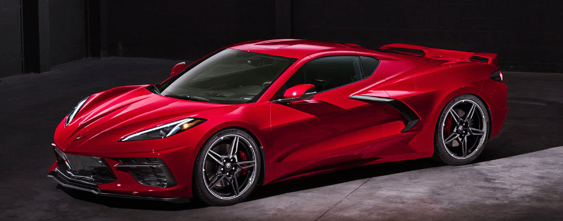 Exterior shot of a red 2020 Corvette with a black background