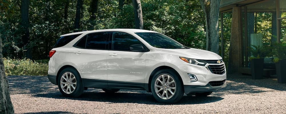 A white 2020 Chevy Equinox Parked on a Gravel Driveway