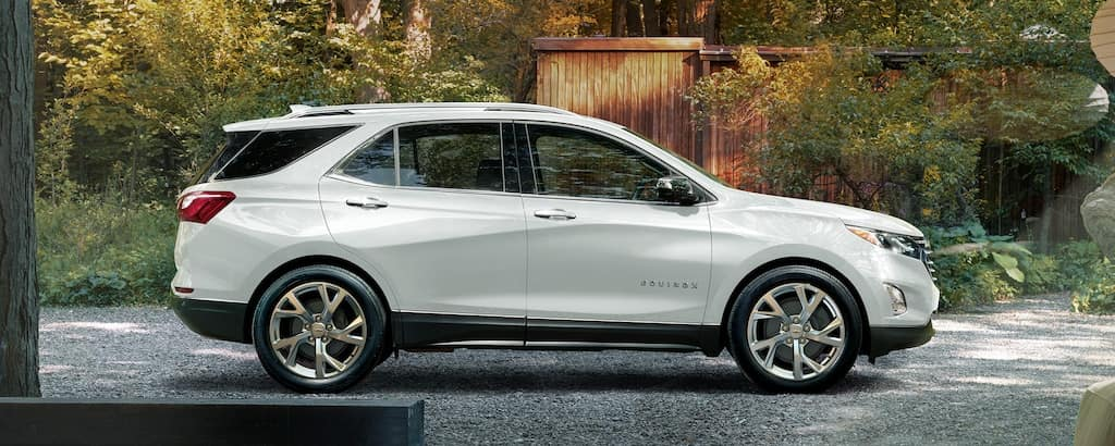 A white 2020 Chevy Equinox parked in a driveway
