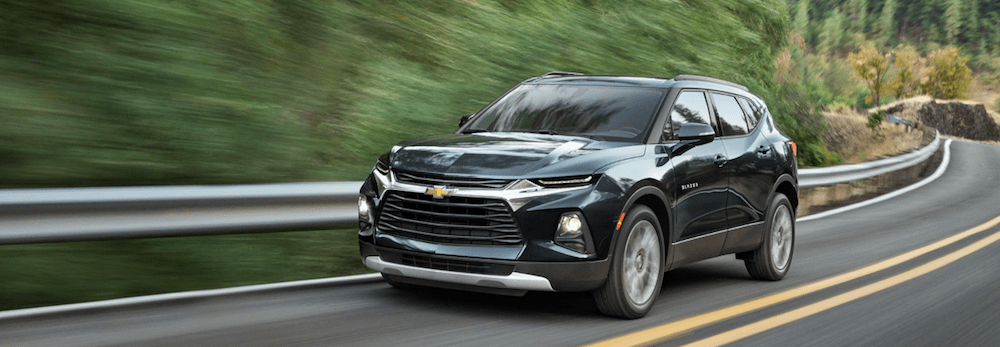 A 2020 Chevy Blazer driving on a mountain road