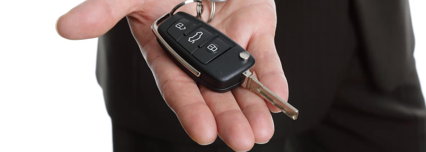 A man holding a Chevy key fob