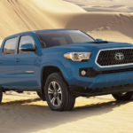Blue 2019 Toyota Tacoma on sand dunes