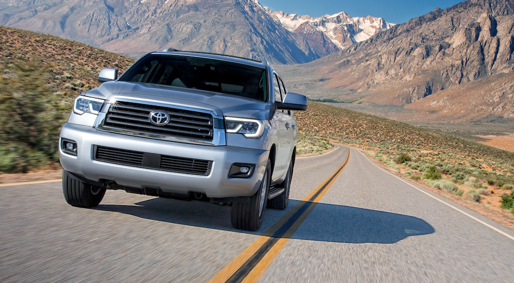 Silver 2019 Toyota Sequoia driving towards camera with mountains in back
