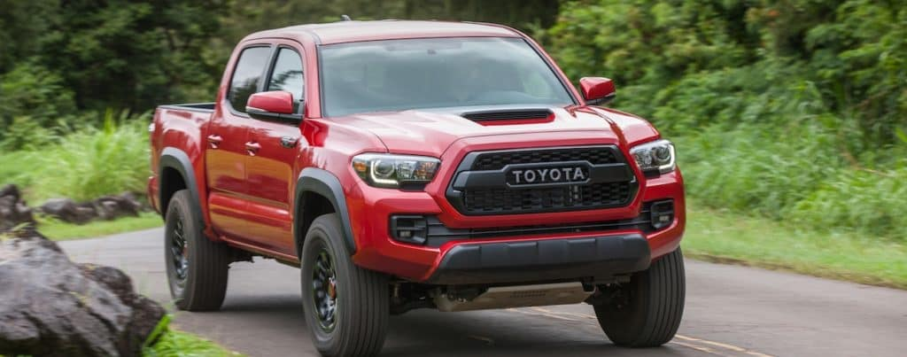 4c1a2925ab8 A red 2019 Toyota Tacoma navigates a twisty road