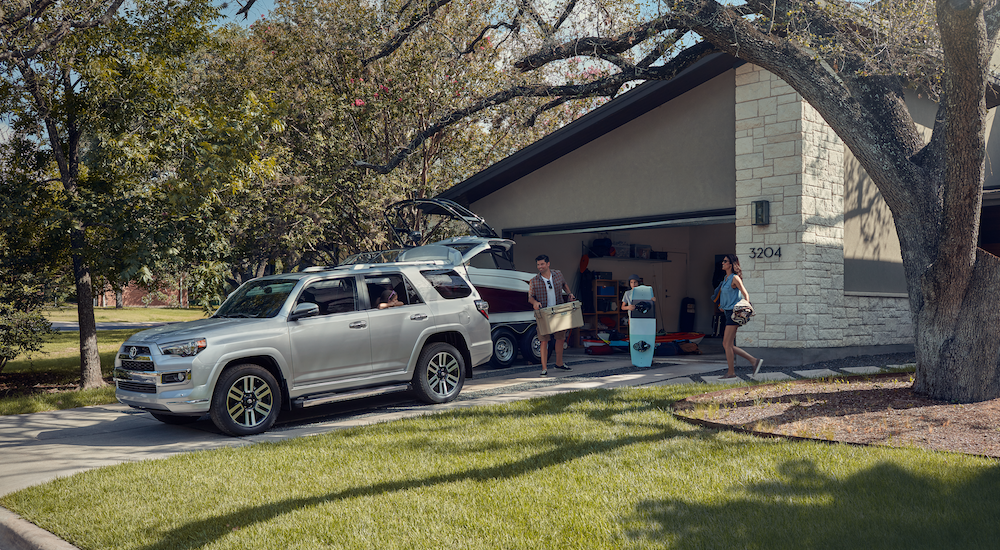 Family loading beach supples into silver 2019 Toyota 4Runner