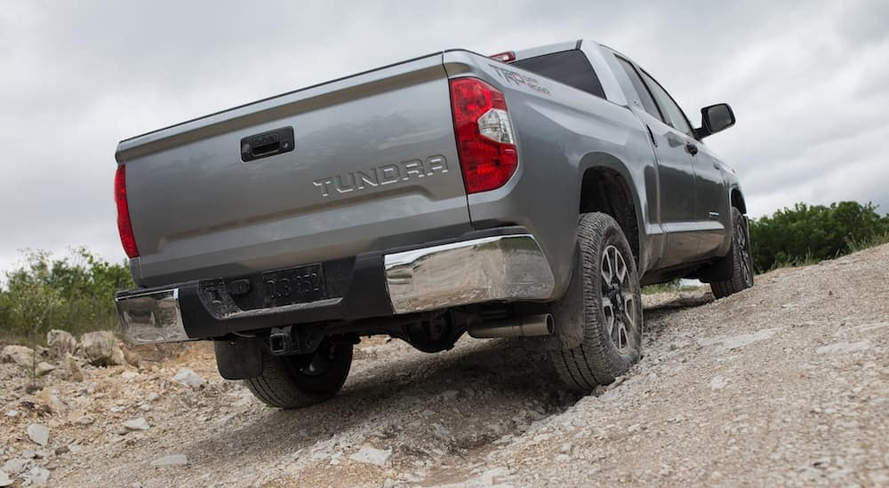 Rear shot of grey 2019 Toyota Tundra off roading