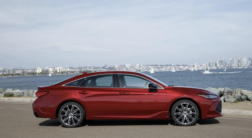 A red 2019 Toyota Avalon parked at the shore