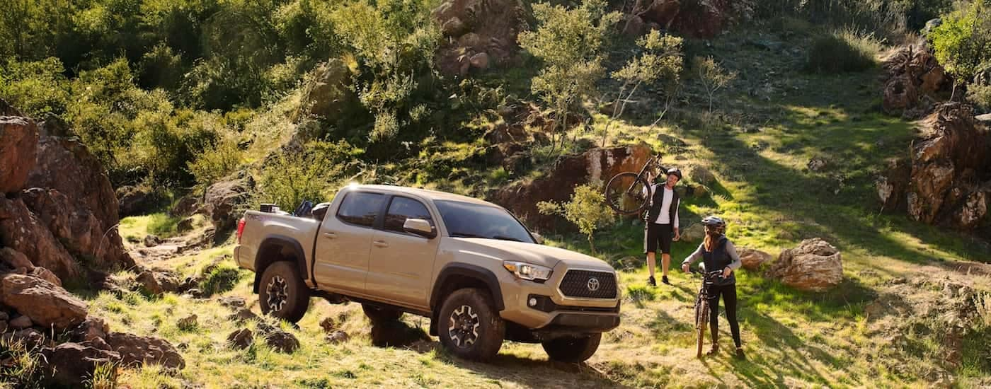 A pair of hikers park their 2019 Toyota Tacoma at a local mountain