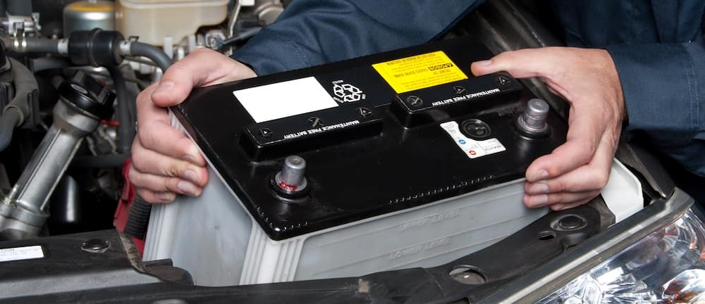 Mechanic Replacing Vehicle Battery