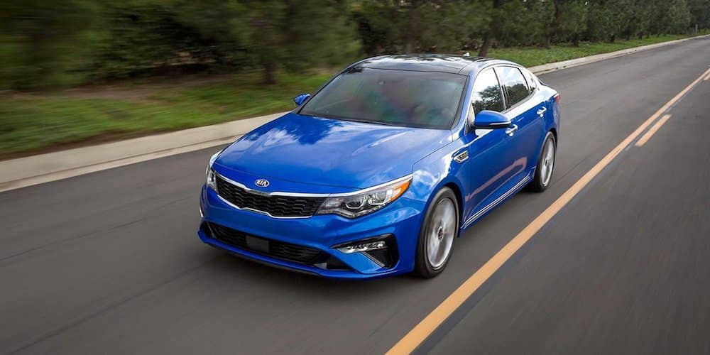 2019 blue optima driving on highway