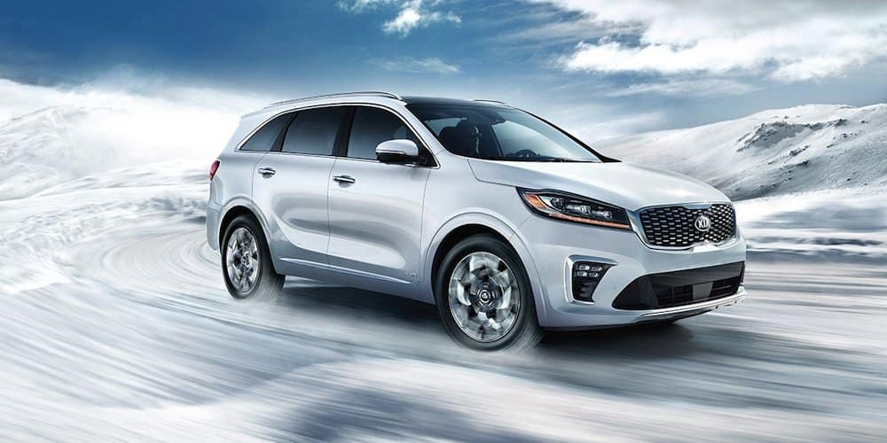 2019 white sorento driving in snow